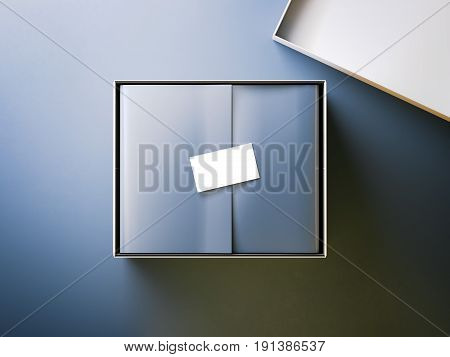White box with blue wrapping paper and business card isolated on bright background. 3d rendering