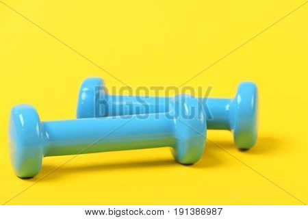 Gym And Sports Training Concept: Two Plastic Coated Dumbbells