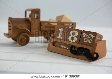 Close up of calender with toy truck on wooden table