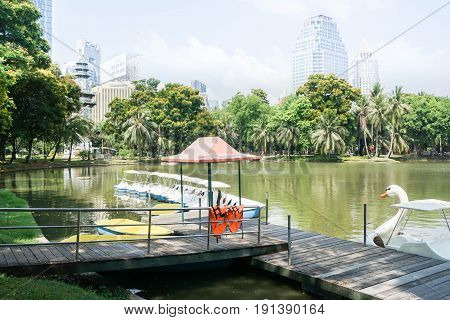 wooden walkway to get in boat and water cycle in public park taken in Lumpini Park Bangkok Thailand on 31 May 2017