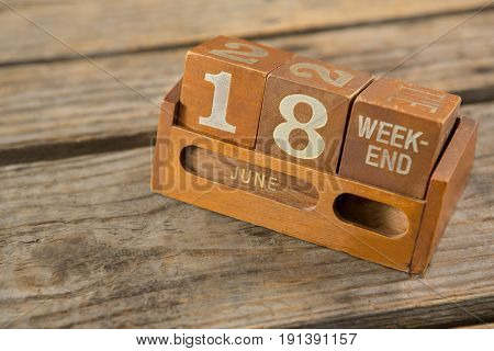 High angle view of wooden calender on table