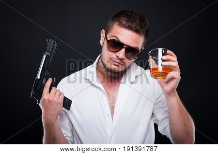 Armed Murderer Rising Up A Glass Of Liqueur