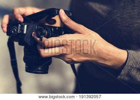 Girl loading analogue photographic Camera