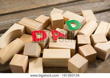 High angle view of dad text on wooden blocks at table