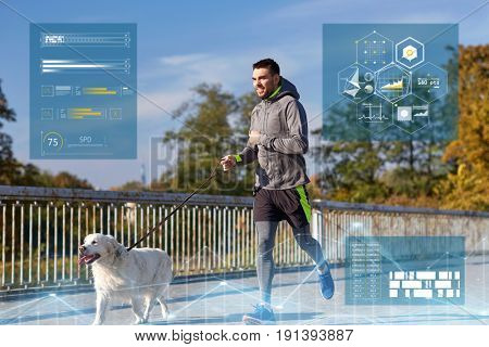 fitness, sport and people concept - happy man with labrador retriever dog running outdoors