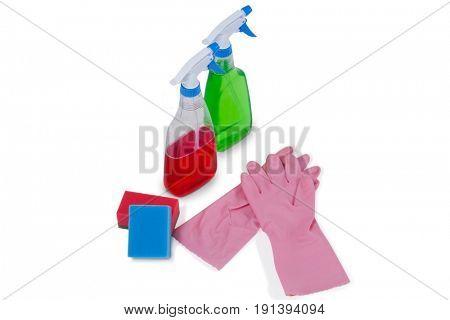 Detergent spray bottles, sponge pad and rubber glove arranged on white background