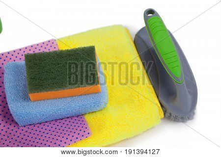 Clothes brush, scouring pad, towel and napkin cloth arranged on white background