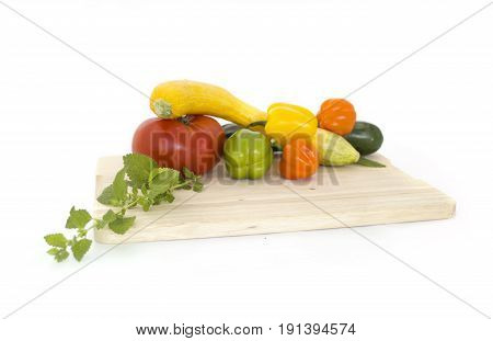 White background with stack of Fresh summer vegetables