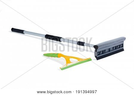 Squeegee and floor mop arranged on white background