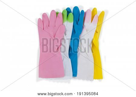 Various colorful rubber gloves on white background