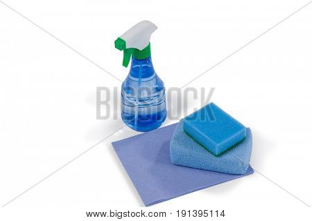 Close-up of spray bottle and scouring pad on white background