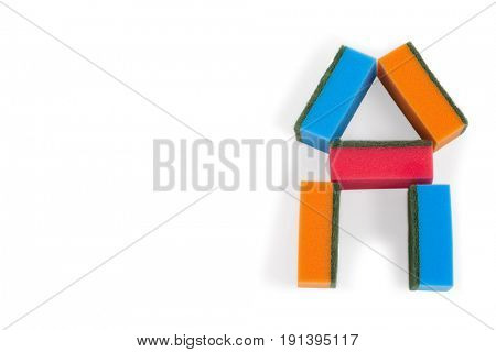 Various scouring pads forming shape of home on white background