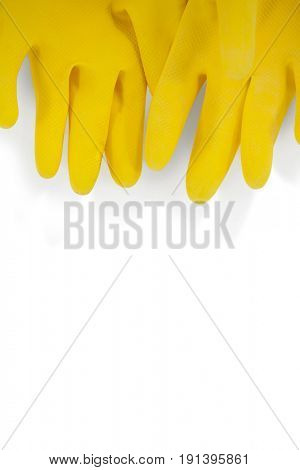 Pair of yellow rubber gloves on white background