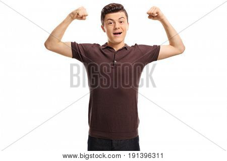 Teenager flexing his muscles and looking at the camera isolated on white background
