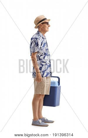 Full length profile shot of an elderly tourist with a cooling box waiting in line isolated on white background