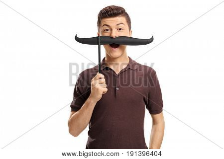 Teenage boy with fake moustaches isolated on white background