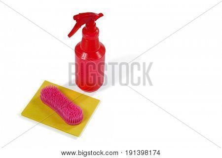 Cleaning spray bottle, sponge and brush on white background