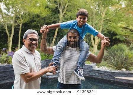 Portrait of happy multi-generation family enjoying together at park
