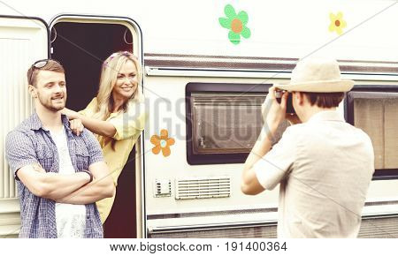 Happy friends taking pictures of each other outdoors at summer. Trip, holiday, vacation, journey concept.