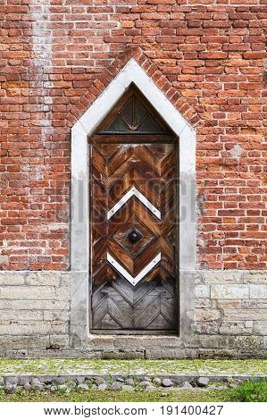Dark Wooden Door In Red Brick Wall, Gothic Revival