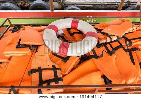 Lifebuoy And Life Jacket On The Ferry To Koh Kret, Thailand.