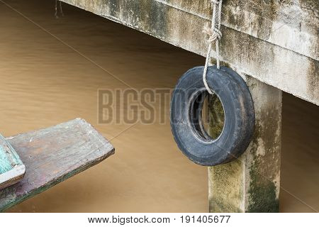 Old Tires Used As A Bumper For Boats Or Big Truck Tires Used For Bump Stop In A Commercial Dock.