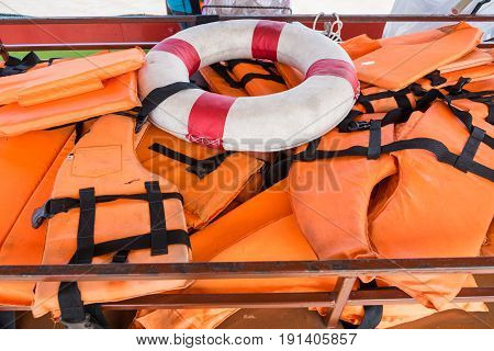 Lifebuoy and Life jacket on the ferry to Koh Kret Thailand
