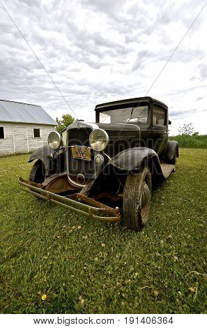 OSAKIS,MINNESOTA, June 15, 2017: The OLD black1931 car is a Chevrolet Coupe, colloquially referred to as Chevy and formally the Chevrolet Division of General Motors Company, is an American automobile division of the American manufacturer.