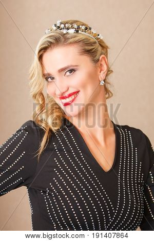 Portrait of attractive blonde woman in black dress