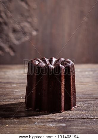 Chocolate souffle home baked in wooden table