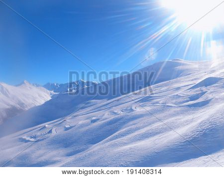 Ski snow and blue sky with sun light, Italian Alps
