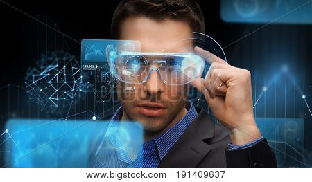 augmented reality, technology, business and people concept -businessman in virtual glasses looking at screen projections over dark background