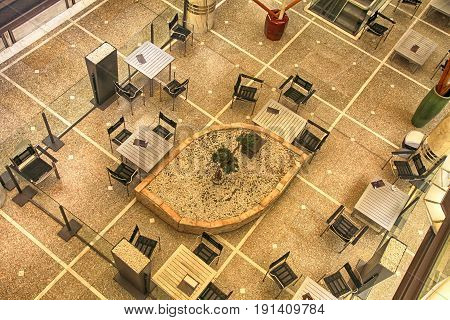 Tables and chairs in contemporary cafe view from above, Switzerland