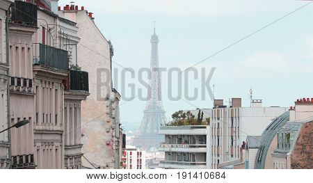 View on Eiffel Tower and urban street in Paris France