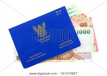 Blue Thai Work Permit book (WP.11) with different Thai Baht inside isolated on white background