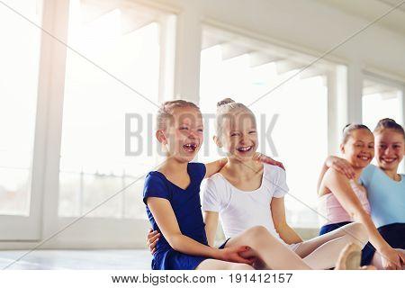 Little Ballerinas Having Fun And Embracing In Ballet Class