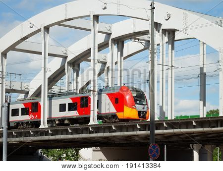 Modern suburban electric train on the bridge