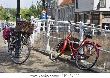 Bicycles near a canal in Delft in the Netherlands