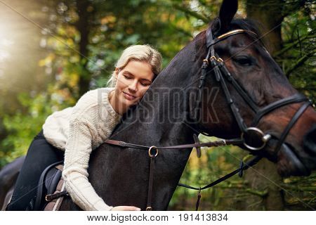 Smiling Woman Hugging Her Horse In Park