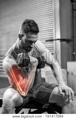 Digitally generated image of male athlete doing excercise with dumbbells at gym