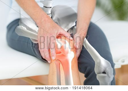 Digitally generated image of man suffering with knee inflamation