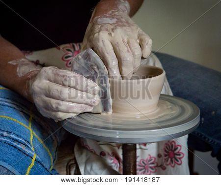 potter man hands make clay jug