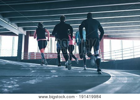 Group Of Young Athletes Running