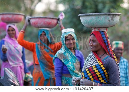 KHAJURAHO, INDIA - JANUARY 5, 2016: Indian women working hard in road-building in Khajuraho, Madhya Pradesh State of India