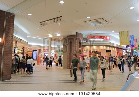 YOKOHAMA JAPAN - MAY 28, 2017: Unidentified people visit World Porters. World Porters is a contemporary shopping mall located in Minato Mirai district.