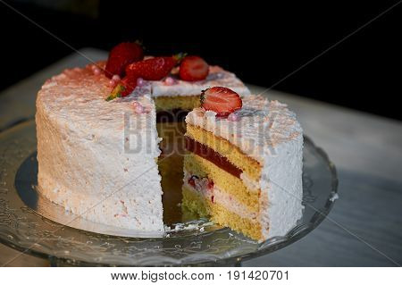 Strawberry yogurt cake.s Consists of butter sponge cakes, covered with cream-based live strawberry yoghurt. Filling : fresh strawberries and strawberry confit. Insanely light and delicate cake.