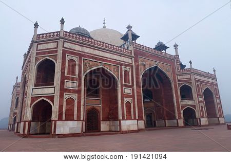 Humayun's Tomb in Delhi, India. The tomb was commissioned by Humayun's son Akbar in 1569-70 and designed by Mirak Mirza Ghiyas a Persian architect chosen by Bega Begum.