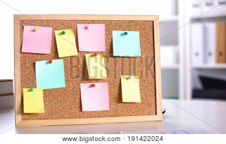 Cork board with notes, clipping path included.