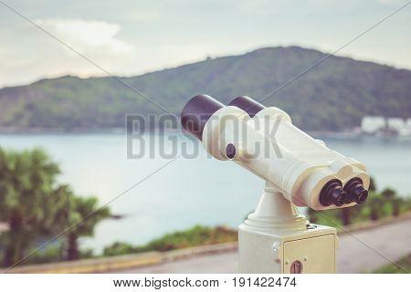 Close up white binoculars camera setup at viewpoint in Phuket Thailand