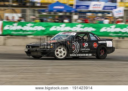 Lviv Ukraine - June 4 2016: Unknown rider on the car brand Nissan overcomes the track in the championship of Ukraine drifting in Lviv Ukraine.